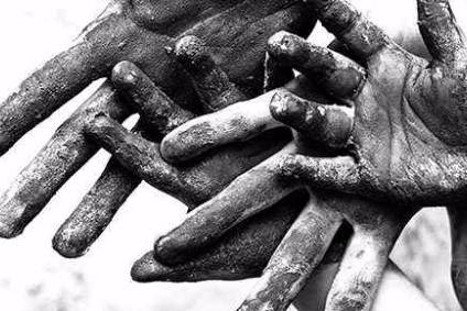 Hands clasped together indicating poverty